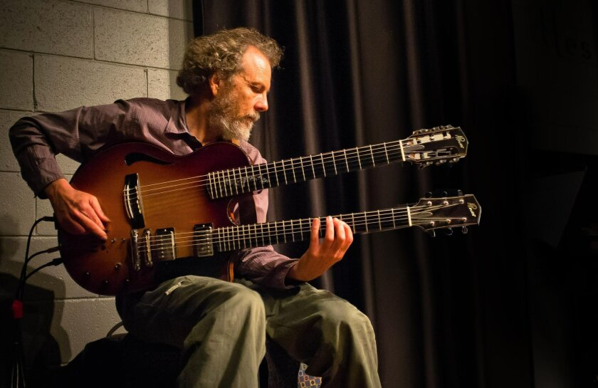 """Encinitas guitar icon Peter Sprague has a new album, """"Dream Walkin',"""" that blends rock and jazz with Latin influence. He says he doesn't feel as though he's settled into a sound — he's still evolving."""