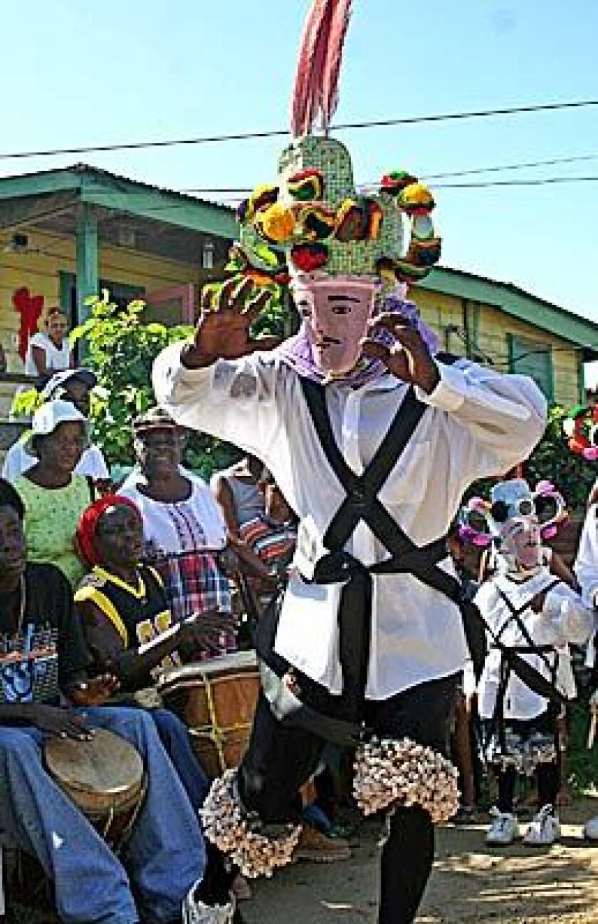 A dancer holds the crowd's attention during Wanaragua, or Jonkonnu - a festival during the Christmas season, in Dangriga, Belize.