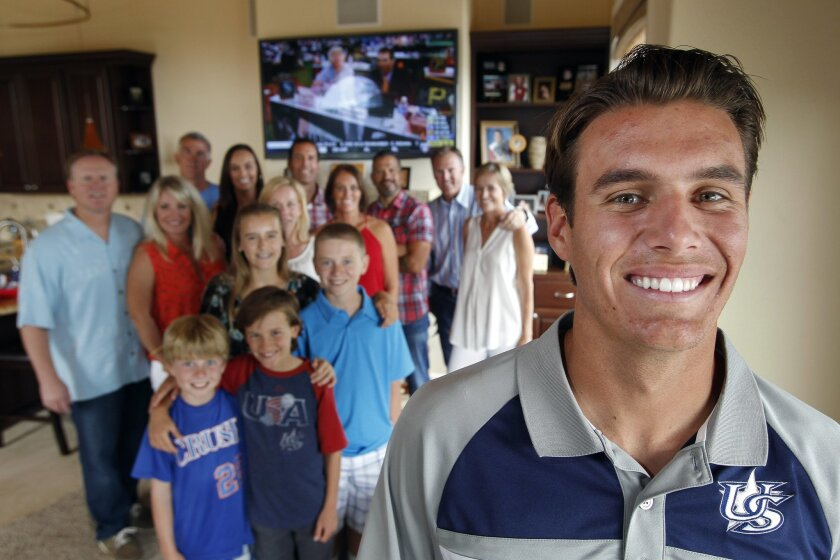 Cathedral Catholic High School pitcher Brady Aiken with family members standing under the TV monitor showing the MLB draft behind him while in his family's Cardiff by the Sea home on Thursday. Aiken was selected by the Houston Astros as the first pick in the MLB First-Year Player draft on Thursday.