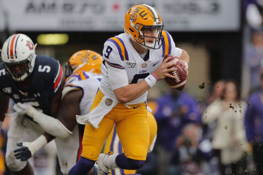 LSU quarterback Joe Burrow scrambles in the first half against Auburn on Saturday.