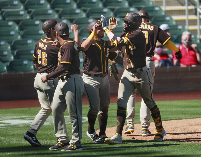 Padres shortstop Fernando Tatis Jr. celebrates with teammates after hitting a grand slam in Tuesday's game.