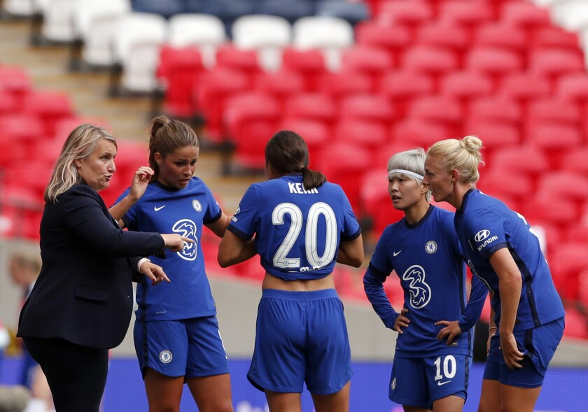 """FILE - In this Saturday, Aug. 29, 2020 file photo, Chelsea manager Emma Hayes, left, gives instructions to her players during their English FA Women's Community Shield soccer match against Manchester City at Wembley stadium in London. Chelsea can reach its first Women's Champions League final if it gets a better performance in the attacking third against Bayern Munich on Sunday, May 2, 2021. Chelsea manager Emma Hayes says her team didn't do well """"in the finishing phase"""" last week in a 2-1 loss to Bayern in the first leg of the semifinals. (Andrew Couldridge/Pool via AP, file)"""