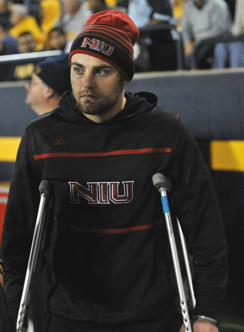 Injured Northern Illinois quarterback Drew Hare stands near the bench during the second half of the team's NCAA college football game against Toledo on Tuesday, Nov. 3, 2015, in Toledo, Ohio. (AP Photo/David Richard)