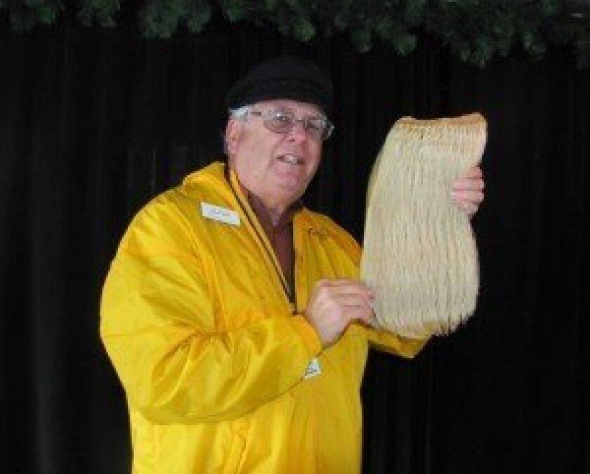 Jim Nelson holding gray whale baleen.