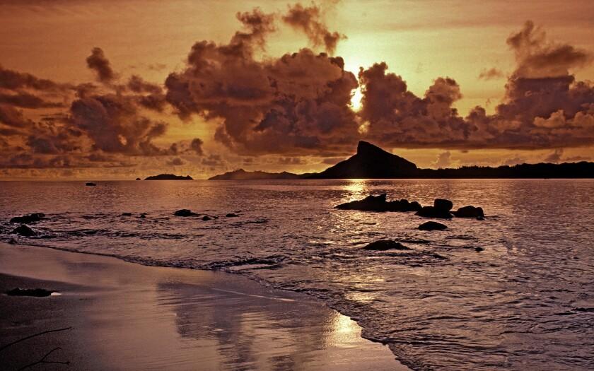 Sunset on the beach on Mangareva Island.