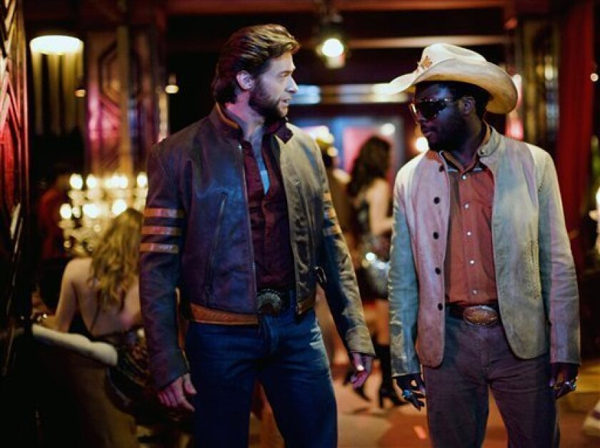 """In this image released by 20th Century Fox, Hugh Jackman stars as Wolverine, left, and Will.i.am stars as John Wraith in """"X-Men Origins: Wolverine"""". (AP Photo/20th Century Fox, James Fisher)"""