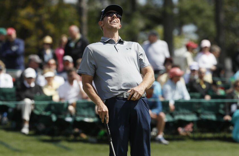 FILE - In this April 8, 2016, file phot,o Hunter Mahan reacts to a missed birdie putt on the 18th hole in the second round of the Masters golf tournament in Augusta, Ga. Once as high as No. 4 in the world, he is at No. 143 and falling. At home, his wife is a month away from having their third child