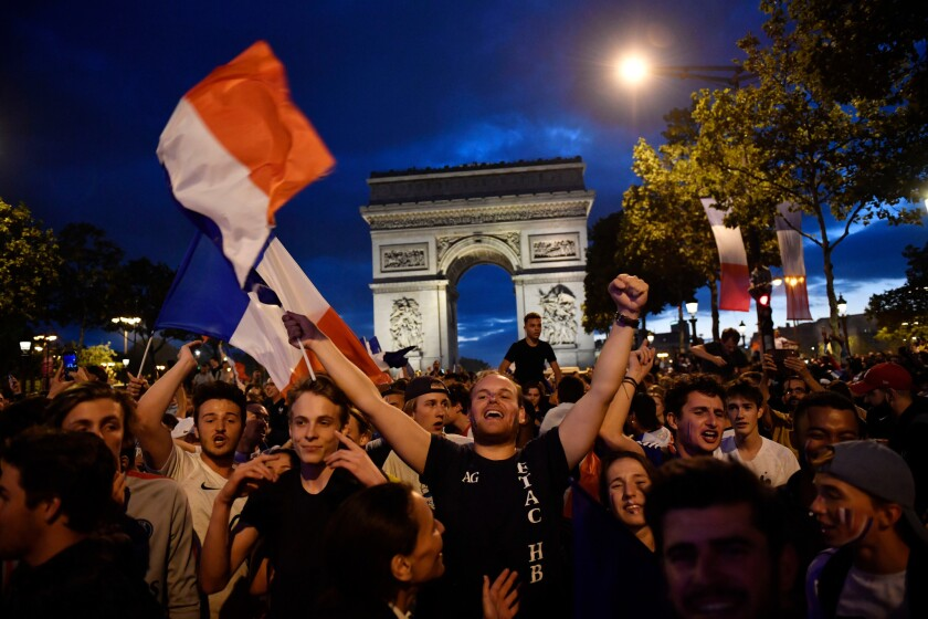 French supporters celebrate on the Champs Elysees after France beat Belgium 1-0 to advance to the World Cup finals.
