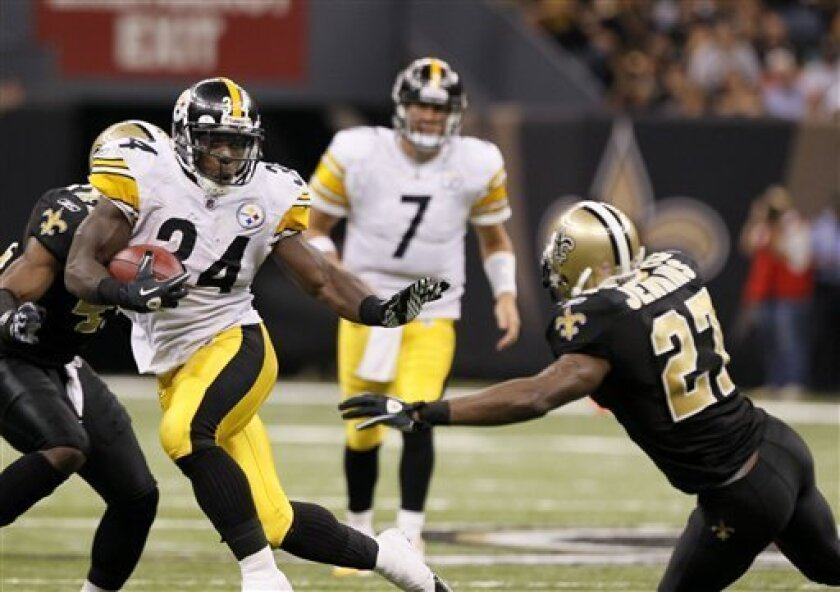 Pittsburgh Steelers running back Rashard Mendenhall (34) eludes New Orleans Saints cornerback Malcolm Jenkins (27) as he rushes for a 38 yard touchdown during the fourth quarter of an NFL football game at the Louisiana Superdome in New Orleans, Sunday, Oct. 31, 2010. (AP Photo/Patrick Semansky)