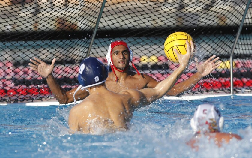 Mt. Carmel's Vishal Bobba can't stop Scripps Ranch's Noah Braun from scoring on this shot  during Scripps Ranch High School's victory over Mt. Carmel  7-2 at the San Diego Section Division ll water polo champions.