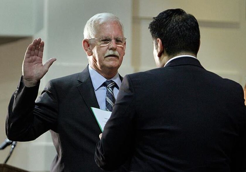 Danny Harber, seen being sworn in as a Bell City Council member, was arrested Tuesday on suspicion of killing his wife.