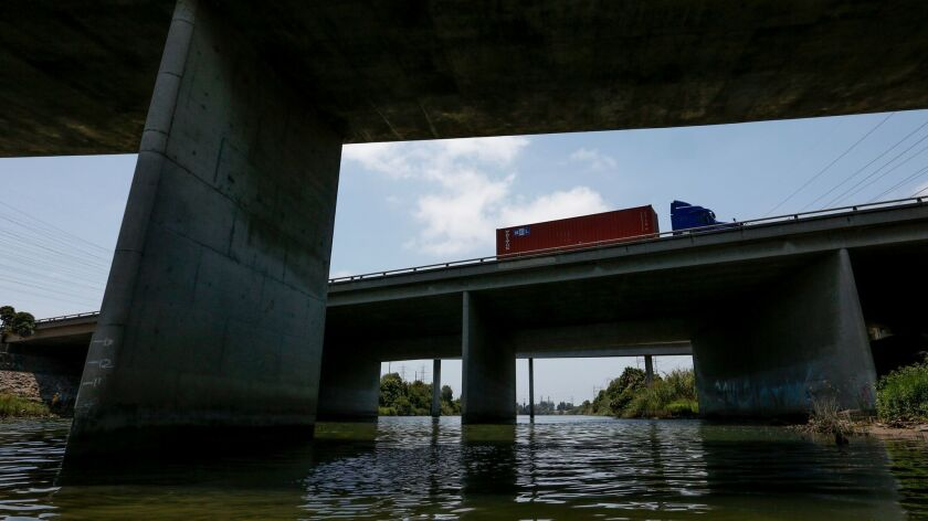 A tractor-trailer drives along the 405 Freeway interchange and connectors as it passes over the San