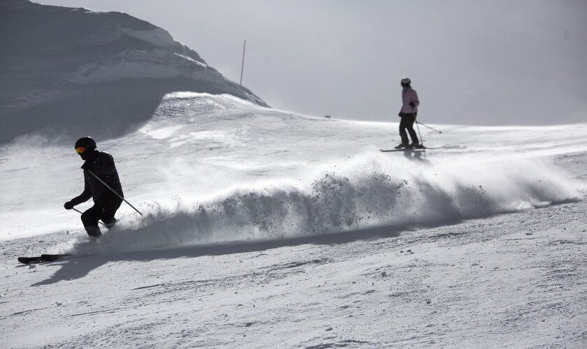 Skiers in the Cornice Bowl enjoy spring-like conditions in early March on the slopes at Mammoth Mountain in Mammoth Lakes. Early-bird passes for next season go on sale today.