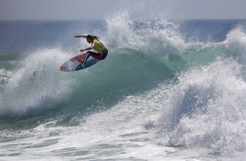 Carissa Moore of Hawaii surfs her way to becoming the world champion.