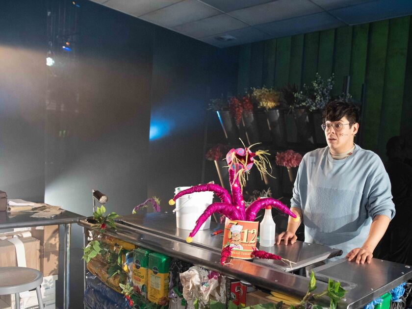 """George Salazar and Audrey II in """"Little Shop of Horrors"""""""