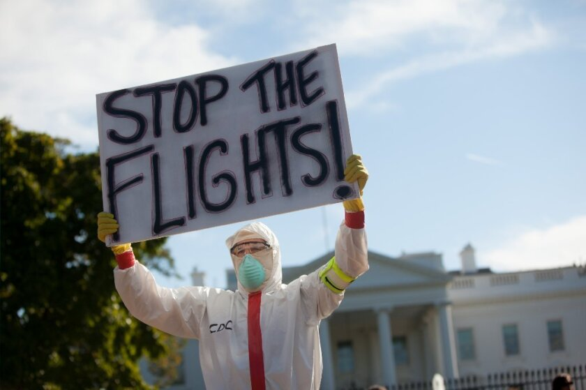 A man dressed in a Hazmat costume protests the entry of Ebola into the United States from Africa at the White House earlier this month.