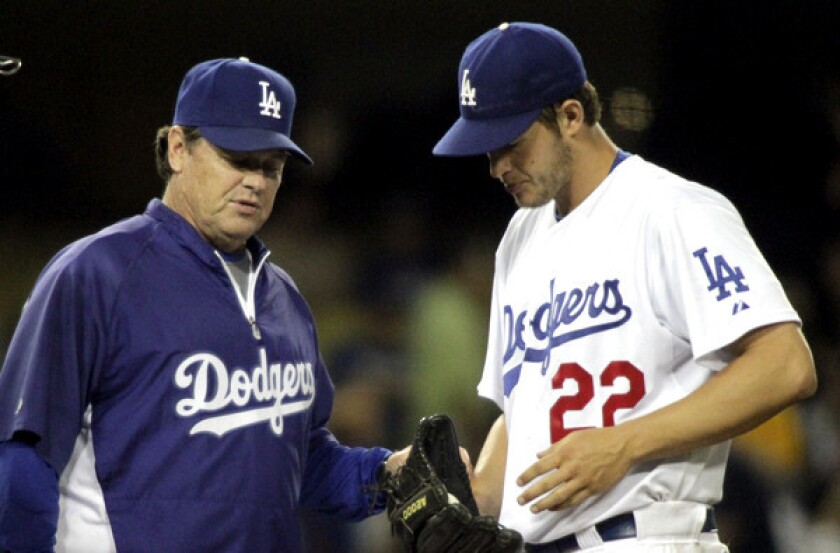 Dodgers pitching coach Rick Honeycutt chats with ace Clayton Kershaw.