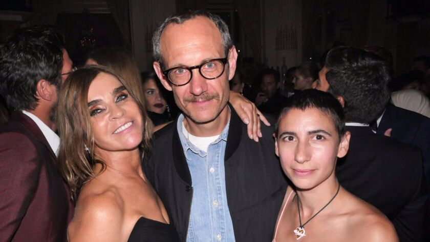 Carine Restoin-Roitfeld, from left, Terry Richardson and Alex Bolotow at the Harper's Bazaar Icons Party during New York Fashion Week.
