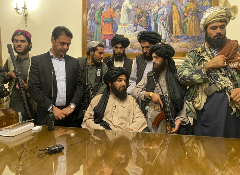 Taliban fighters took control of the presidential palace in Kabul after President Ashraf Ghani fled on Sunday.