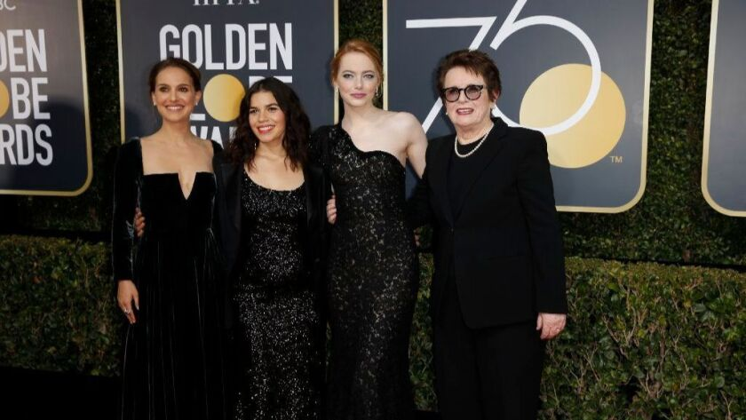 Actresses Natalie Portman, America Ferrera and Emma Stone and former tennis player Billie Jean King arrive dressed in black at the 75th Golden Globes at the Beverly Hilton Hotel on Jan. 7.