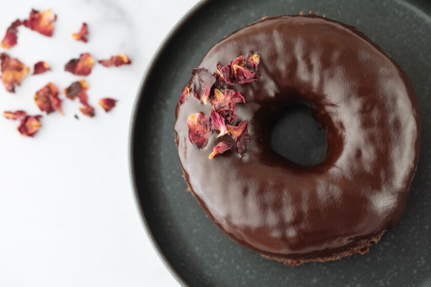 Sidecar's Red Wine Chocolate doughnut, sprinkled with edible rose petals.