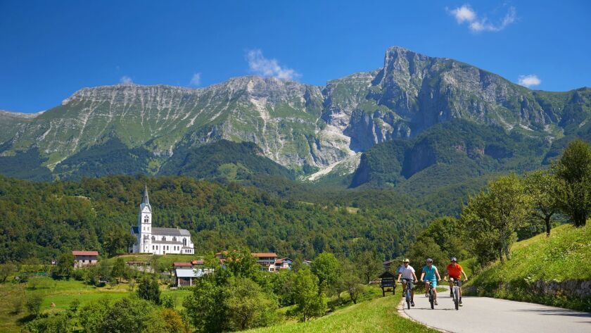 SLOVENIA - Bicyclists ridding e-bikes in Soca Valley. Bicycle Adventures e-bike tour.