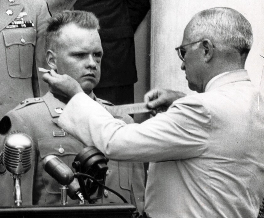 Einar H. Ingman Jr., left, receives a Medal of Honor from President Truman on July 5, 1951.