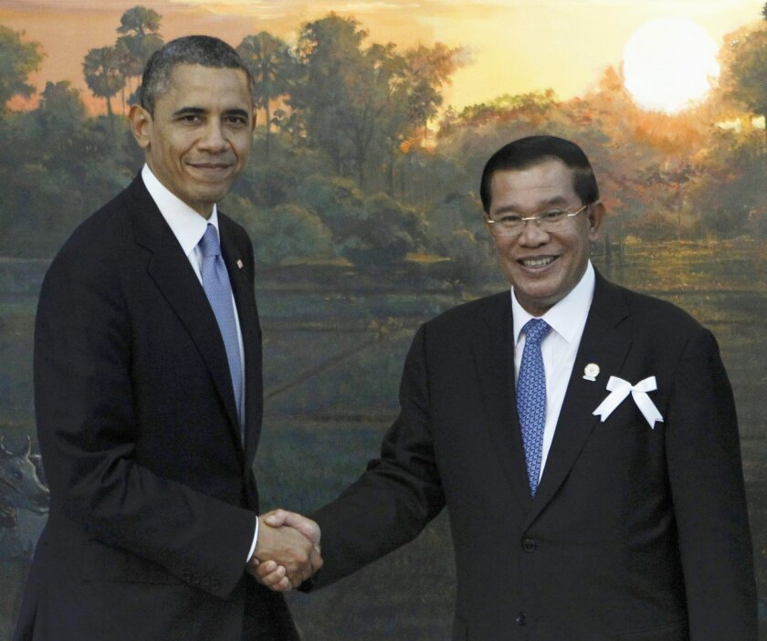 FILE - In this Nov. 19, 2012 file photo, President Barack Obama shakes hands with Cambodia's Prime Minister Hun Sen in Phnom Penh, Cambodia. When President Barack Obama welcomes Southeast Asian leaders for a shirt-sleeves summit in California this week, he'll have some interesting dining companions