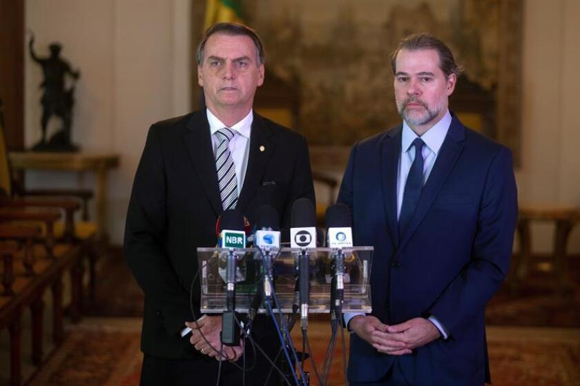 Brazil's President-elect Jair Bolsonaro (L) delivers a press conference with the president of the Supreme Court, Jose Antonio Dias Toffoli, in Brasilia, Brazil, Nov. 7, 2018. EPA-EFE/Joedson Alves