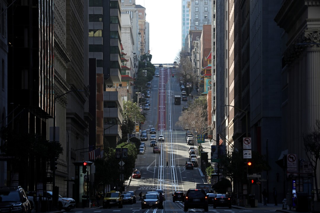 California Street in downtown San Francisco with buildings and cars but no cable cars on its tracks.