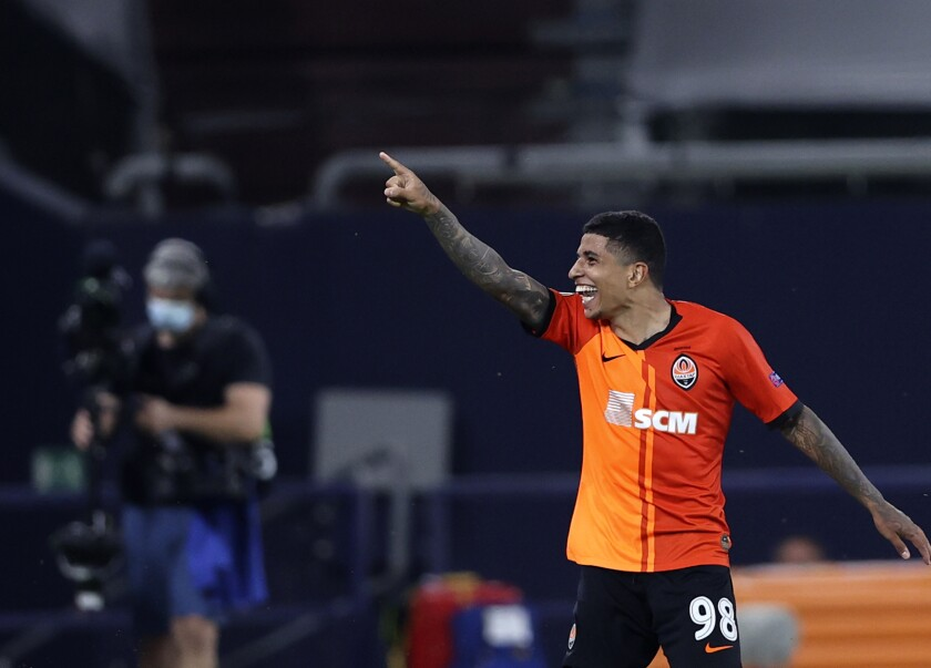 Shakhtar's Dodo celebrates after scoring his side's fourth goal during the Europa League quarter finals soccer match between FC Shakhtar Donetsk and FC Basel at the Veltins-Arena in Gelsenkirchen, Germany, Tuesday, Aug. 11, 2020. (Wolgang Rattay/Pool Photo via AP)