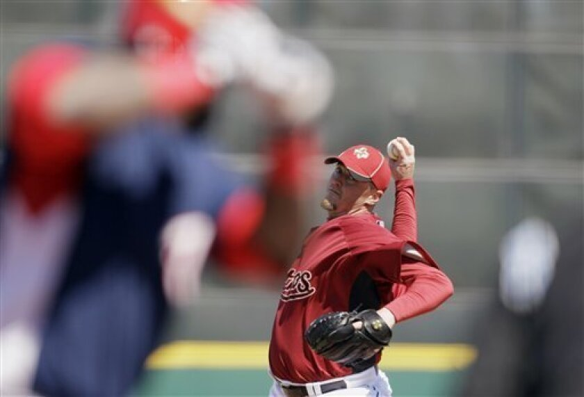 Houston Astros pitcher Brett Myers throws to a Washington Nationals batter during the first inning of a spring training baseball game, Thursday, March 4, 2010, in Kissimmee, Fla. (AP Photo/Rob Carr)