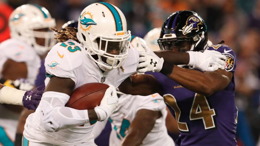 Miami running back Jay Ajayi carries the ball against the Baltimore Ravens on Oct. 26.