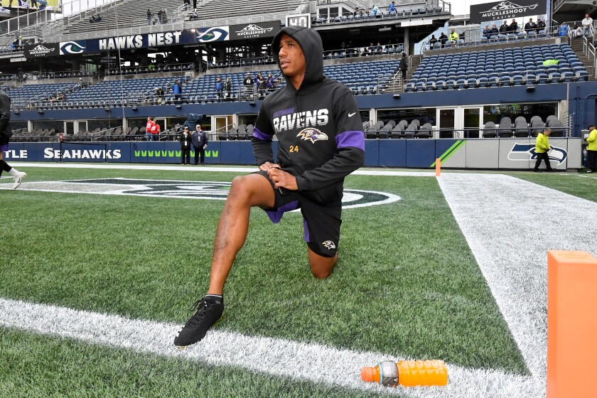 Baltimore Ravens cornerback Marcus Peters warms up before a game against the Seattle Seahawks on Oct. 20.