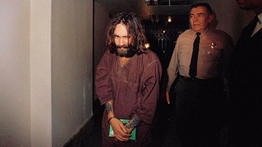 Charles Manson is escorted to court in Los Angeles in 1969.