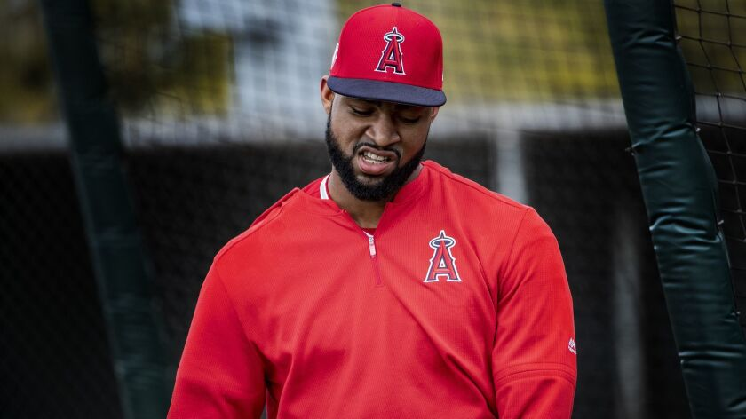 Angels outfielder Jo Adell exits the batting cage during a spring workout last month in Tempe, Ariz.
