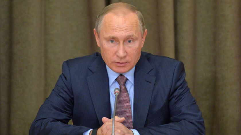 Russian President Vladimir Putin, shown Tuesday in Sochi, has signed a decree withdrawing support for the International Criminal Court.