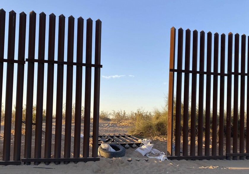 This photo provided by the US Customs and Border Protection shows a hole cut into Southern California's border fence with Mexico on Wednesday, March 3, 2021. Thirteen people killed in one of the deadliest border crashes on record were among more than 40 migrants who entered the U.S. through the hole cut into Southern California's border fence with Mexico, the Border Patrol said Wednesday. (US Customs and Border Protection via AP)