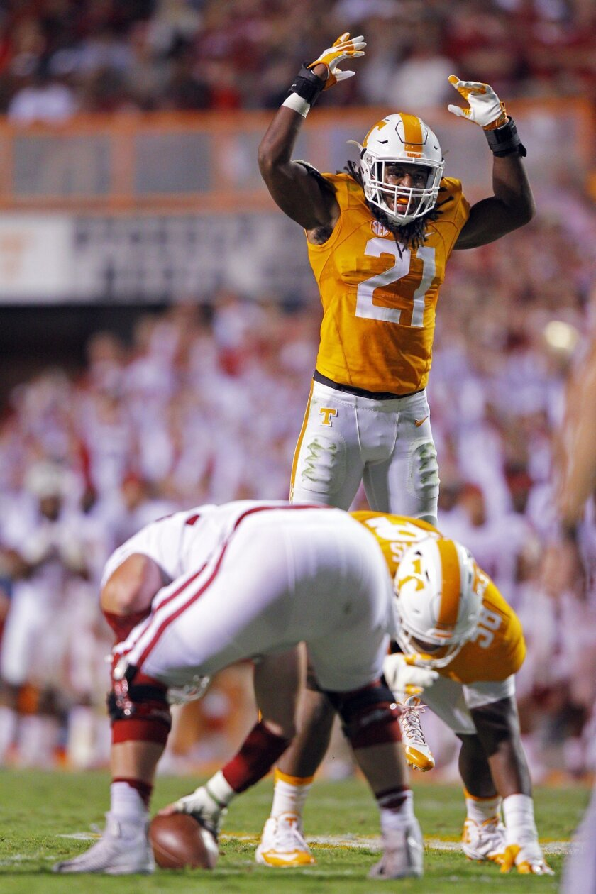 FILE -i In this Sept. 1, 2015, file photo, Tennessee linebacker Jalen Reeves-Maybin (21) tries to get the fans to yell during an NCAA college football game against Oklahoma in Knoxville, Tenn. Reeves-Maybin has emerged as one of the nation's most prolific tacklers in his junior season, yet he still sees room for improvement. The Volunteers need him to step up even more as they deal with life without injured defensive end/linebacker Curt Maggitt. (AP Photo/Wade Payne, File)