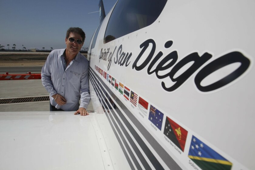 """Flying his plane named """"Spirit of San Diego,"""" pilot Robert DeLaurentis circumnavigated the globe, taking off from San Diego in May and returning in August. At a press availability at Landmark Aviation, DeLaurentis talked about his trip and was greeted by admirers."""