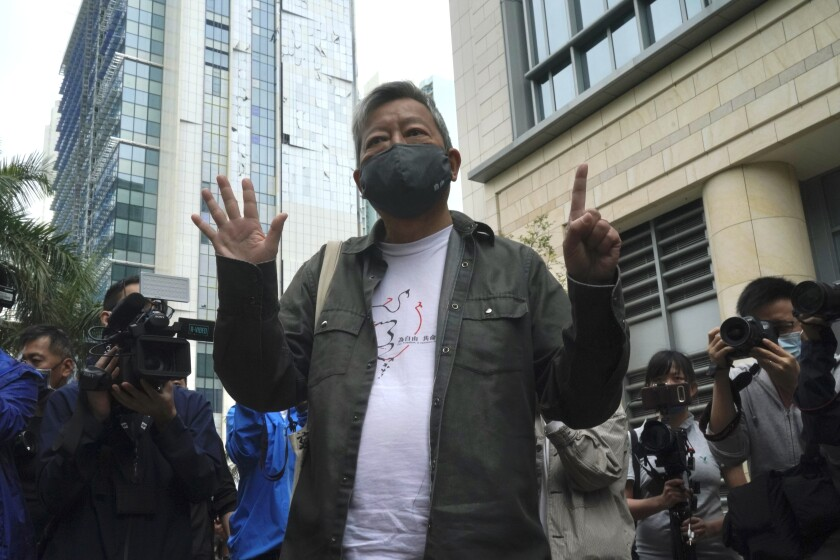 Pro-democracy activist Lee Cheuk-yan, gestures before his sentencing at a court in Hong Kong Friday, April 16, 2021. A Hong Kong court on Friday sentenced five leading pro-democracy advocates, including media tycoon Jimmy Lai, to up to 18 months in prison for organizing a march during the 2019 anti-government protests that triggered an overwhelming crackdown from Beijing. (AP Photo/Kin Cheung)