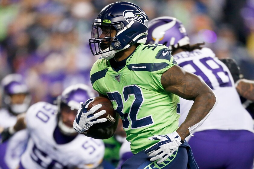 Seahawks running back Chris Carson rushed for 102 yards in 23 carries and had a touchdown in Seattle's 37-30 victory over the Minnesota Vikings on Nov. 2.