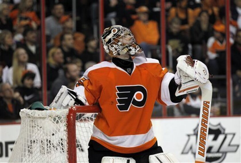 Philadelphia Flyers goalie Sergei Bobrovsky (35) from Russia, watches the replay after allowing a third goal in the first period of an NHL hockey game against the Ottawa Senators, Saturday, March 31, 2012 in Philadelphia. (AP Photo/Alex Brandon)