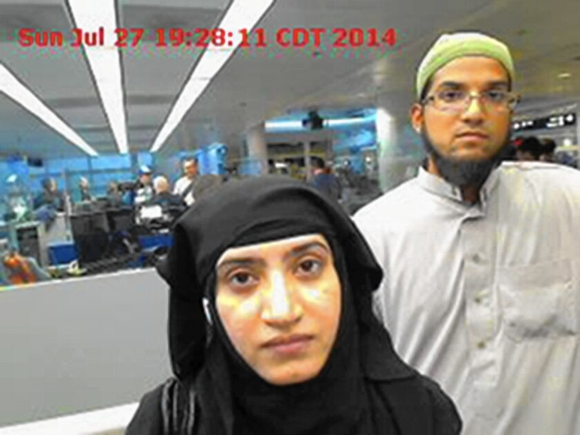 Tashfeen Malik and her husband, Farook, in a photo taken by authorities at Chicago's O'Hare airport in July 2014.