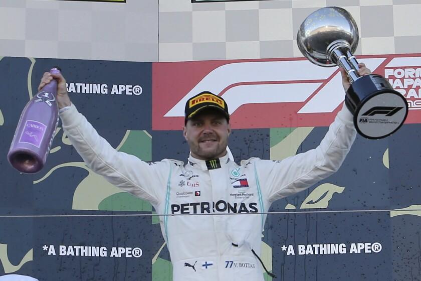 Formula One driver Valtteri Bottas celebrates on the podium after winning the Japanese Grand Prix on Sunday.
