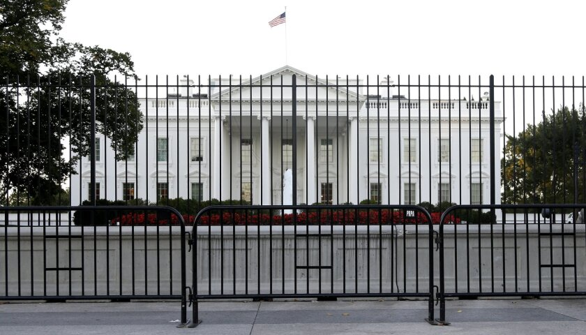 FILE - In this Sept. 22, 2014, file photo, The White House is viewed from Pennsylvania Avenue in Washington. Republicans and Democrats feel a massive disconnect with their political parties and report an overwhelming feeling of helplessness heading into the next phase of the presidential election,