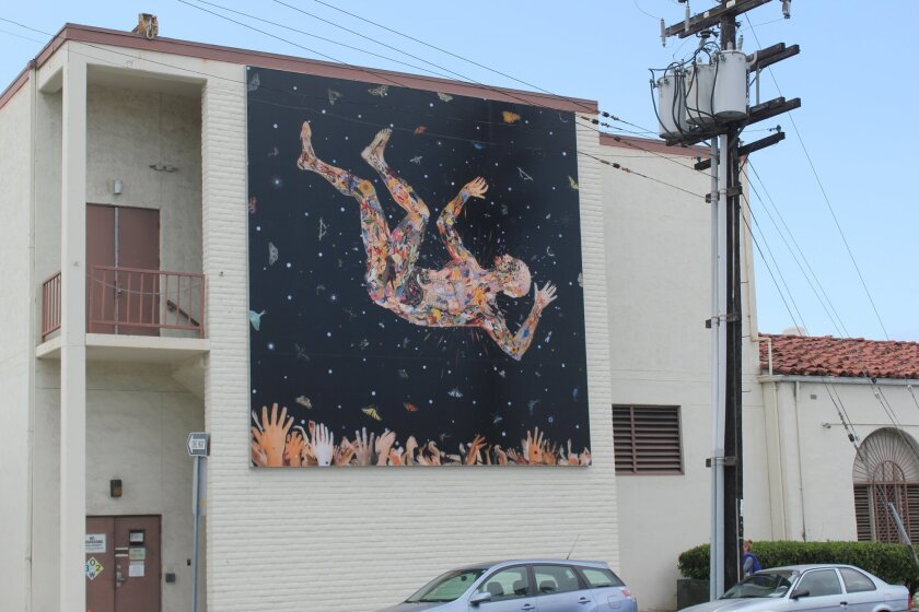 Fred tomaselli's mural 'Learning to Fly for the Zeros,' near the corner of Girard avenue and torrey Pines road, was installed april 22. Pat sherman