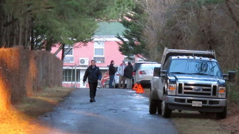 State Department officials block the entrance to a Russian compound Dec. 29 near Centreville, Md.