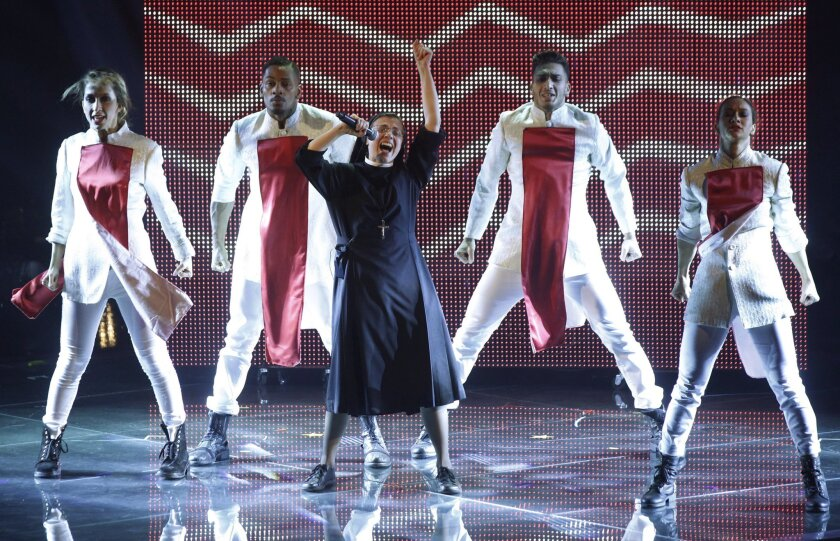 "Sister Cristina Scuccia, performs during the final of the Italian version of the TV talent show ""The Voice"" in Milan, Italy, Thursday, June 5, 2014. With her full habit, sensible shoes and cheering nuns in her camp, Sister Cristina Scuccia made it to Thursday's finals of the Italian version of ""The Voice"" after capturing the attention of millions of YouTube viewers, with her first-round performance in March. (AP Photo/Luca Bruno)"