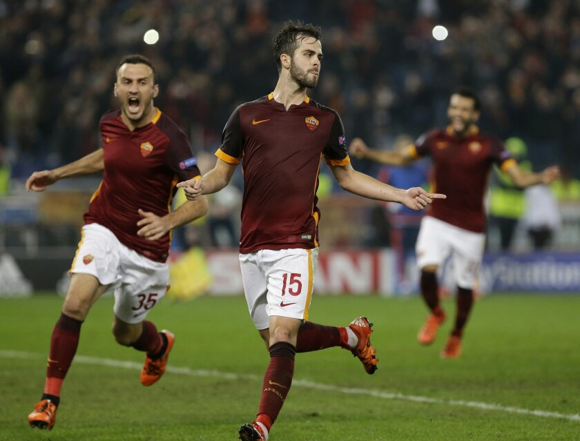Roma's Miralem Pjanic, right, celebrates with his teammate Vasilis Torosidis after scoring during the Champions League group E soccer match between Roma and Bayer Leverkusen at the Olympic stadium, in Rome, Italy, Wednesday, Nov. 4, 2015. (AP Photo/Gregorio Borgia)